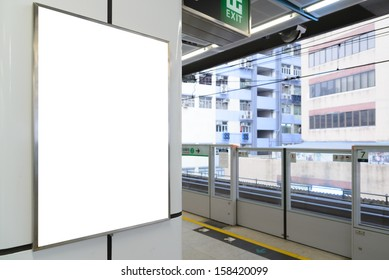 One big vertical / portrait orientation blank billboard in public transport
