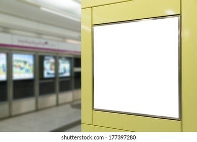 One big vertical / portrait orientation blank billboard in public transport with subway platform background