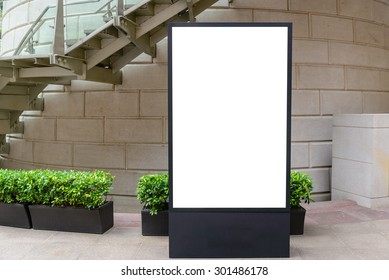 One big vertical / portrait orientation blank billboard in park