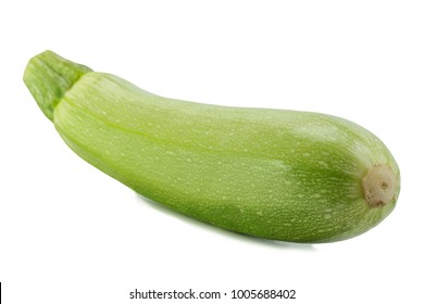 one big whole young zucchini over white background