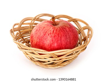 One bigred apple in the basket isolated on white background