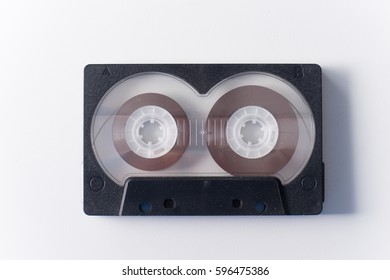 One black audio cassette on white background.
