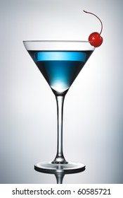 One blue cocktail martini with cherry (pen clip path included)