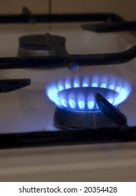 one blue flame on gas stove
