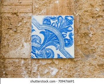 One blue Portuguese tile (azulejo) alone on the wall in Lisbon, Portugal