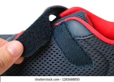 One blue sneakers with Velcro fastener isolated on white. Clothe-up. Sport shoes. Side view.