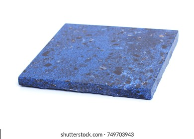 one blue tile from artificial stone on a white background