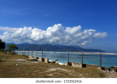 one blurry image of morning view at Gili Trawangan, Lombok. You'll immediately be greeted beautiful blue water and a white sand beach.
