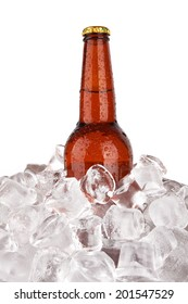 One bottle of beer on ice isolated on white background