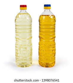 One bottle of unrefined cold pressed sunflower oil and bottle of refined oil on a white background