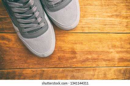 One brand new pair of sport shoes on the wooden table