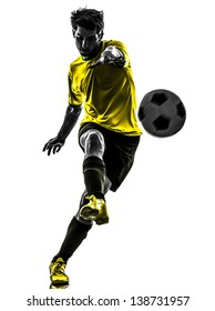 one brazilian soccer football player young man kicking in silhouette studio isolated on white background