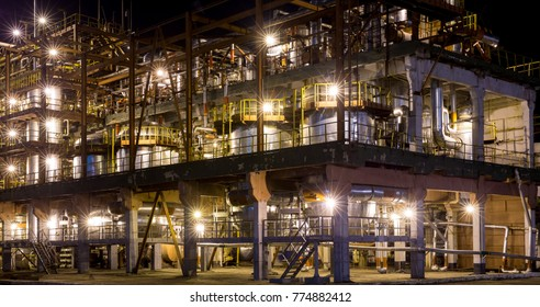 one building at  chemical plant with night illumination