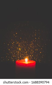 one burning red wax candle with glittering copy space background