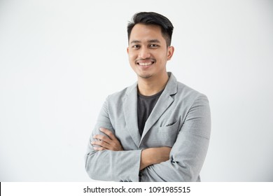 One business man smiling with arms folded through the camera