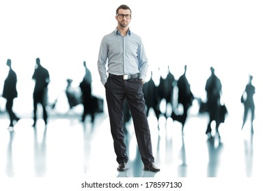 One business man standing in front of crowd