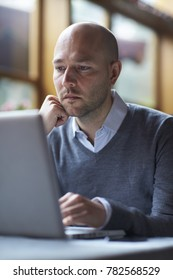 One businessman using computer in cafe