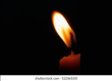 One Candle light on black background