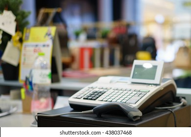 One cash register with a bar code reader.