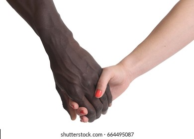 One caucasian and one african hand on white background