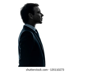 one caucasian business man serious portrait profile   in silhouette studio isolated on white background