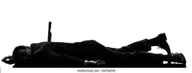 one caucasian business man Stabbed in the Back in silhouette  on white background