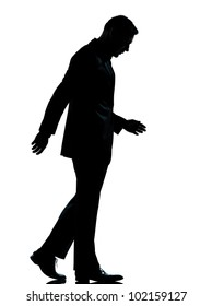 one caucasian business man walking silhouette Full length in studio isolated on white background