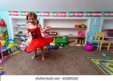 One  Caucasian Child Plays Alone While Dancing In Her Suburban Home Play Room
