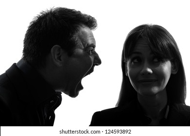 one caucasian couple man screaming  woman  in silhouette studio isolated on white background