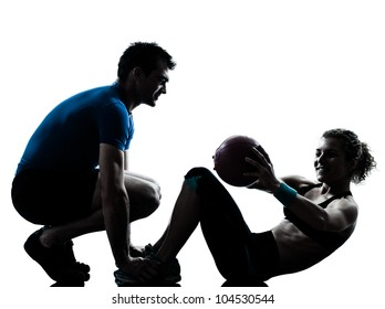one caucasian couple man woman personal trainer coach exercising weights fitness ball silhouette studio isolated on white background
