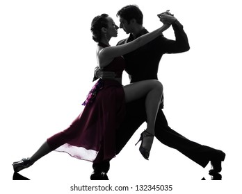 one caucasian couple man woman ballroom dancers tangoing  in silhouette studio isolated on white background