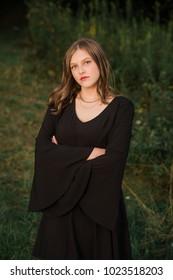 One Caucasian High School Senior Girl Wearing Black Dress at Sunset