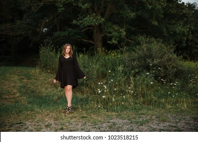 One Caucasian High School Senior Girl Wearing Black Dress at Sunset