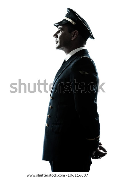 one caucasian man in airline pilot uniform silhouette in studio isolated on white background