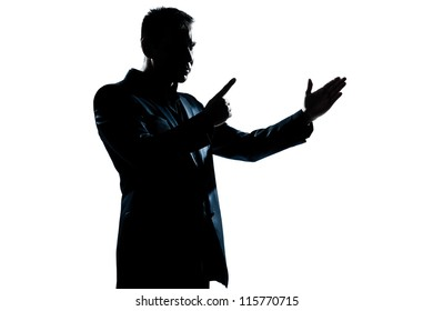 one caucasian man angry menacing portrait silhouette in studio isolated white background