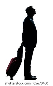 one caucasian man business traveler waiting looking up full length silhouette in studio isolated white background