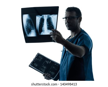 one caucasian man doctor surgeon radiologist medical examining lung torso  x-ray image silhouette isolated on white background