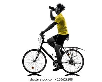 one caucasian man exercising bicycle mountain bike drinking   on white background