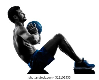 one caucasian man exercising fitness weights Medicine Ball exercises in studio silhouette isolated on white background