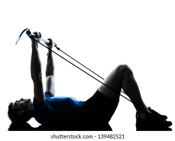 one caucasian man exercising gymstick workout fitness in silhouette studio  isolated on white background