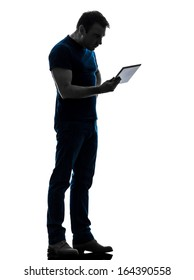 one caucasian man holding watching digital tablet  in silhouette on white background