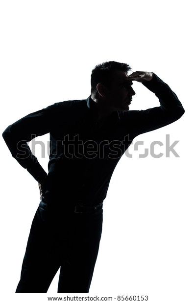one caucasian man portrait  looking forward gesture silhouette in studio isolated on white background