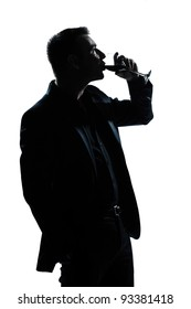 one caucasian man portrait silhouette drinking red wine in studio isolated white background