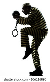 one caucasian man prisoner criminal escaping with chain ball in studio isolated on white background