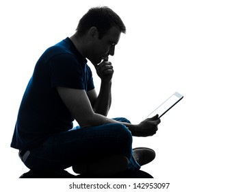 one caucasian man  sitting holding digital tablet   in silhouette on white background