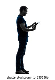 one caucasian man touchscreen digital tablet   in silhouette on white background