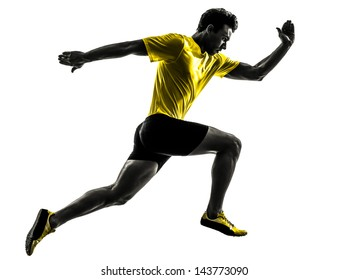 one caucasian man young sprinter runner running  in silhouette studio  on white background