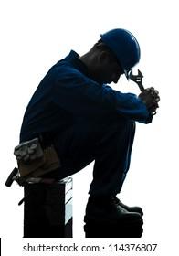 one caucasian repairman worker sad fatigue failure  silhouette in studio on white background