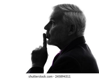 One Caucasian Senior Business Man hushing finger on lips Silhouette White Background