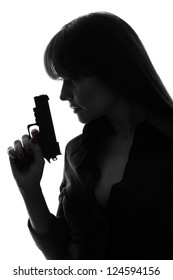 one caucasian sexy detective  woman holding  gun in silhouette studio isolated on white background